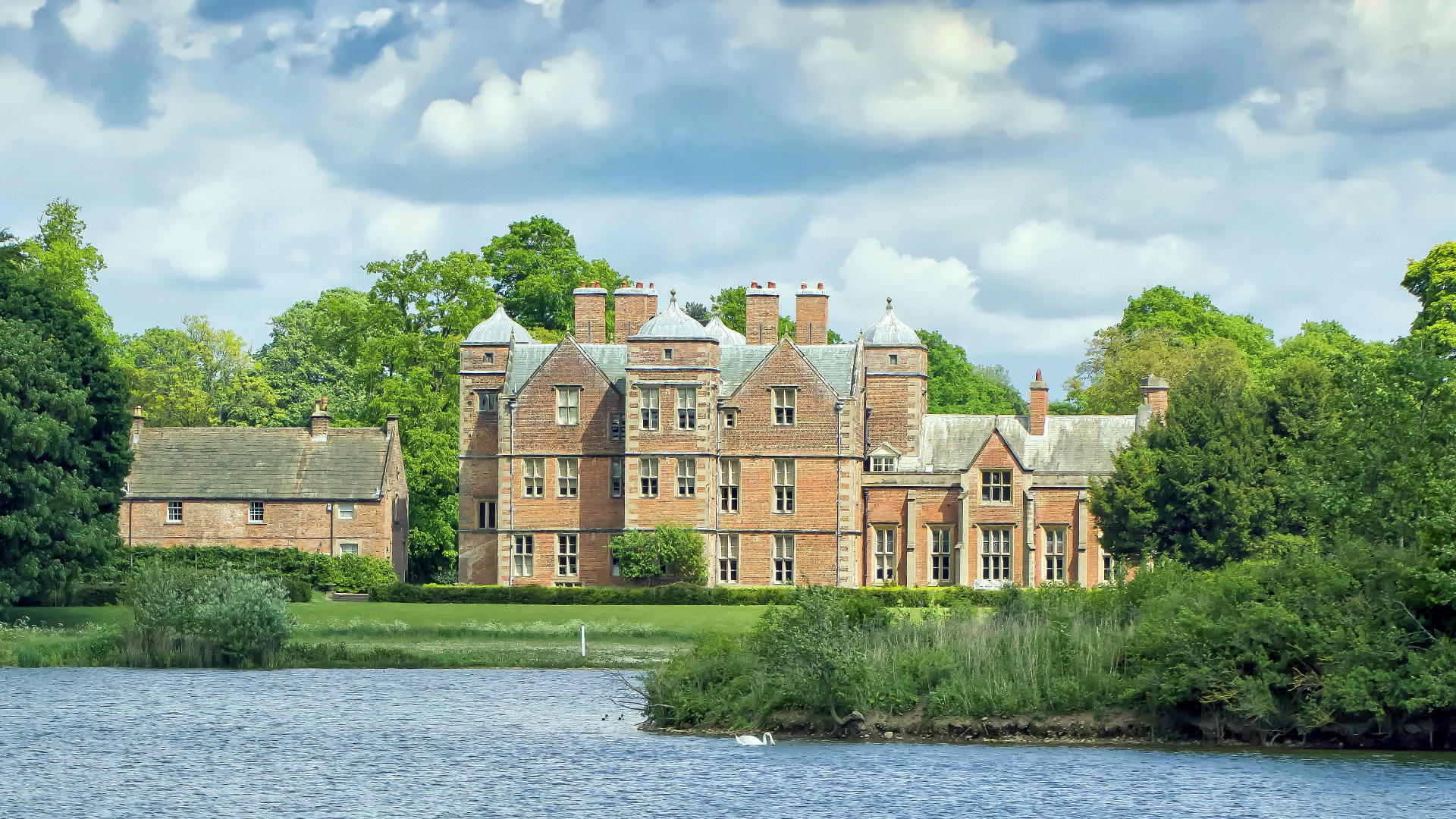 Kiplin Hall pictured across the lake