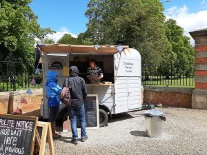 Proper Pizzas serving from their wood fire oven in a converted horse box